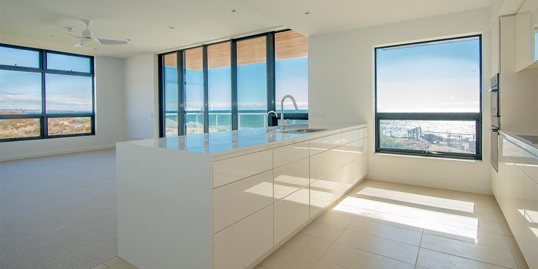 Apartment kitchen looking out to sea