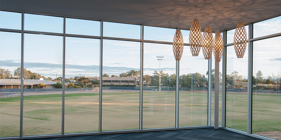 Large glass windows overlooking the oval
